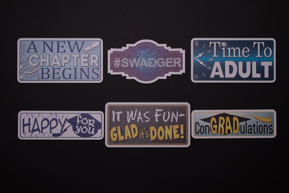 Graduation Sign Package has six signs, they are: A New Chapter Begins, #Swagger, Time To Adult, Happy For You, It Was Fun-Glad It's Done, ConGradulations