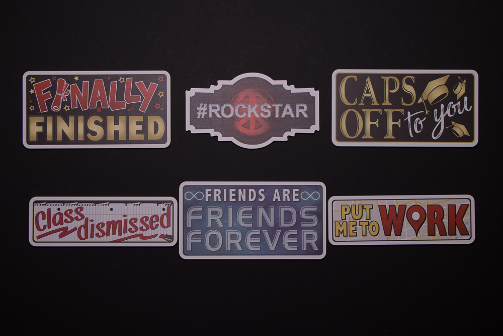 Graduation Sign Package has six signs, Finally Finished, #Rockstar, Caps Off To You, Class Dismissed, Friends Are Friends Forever, Put Me To Work