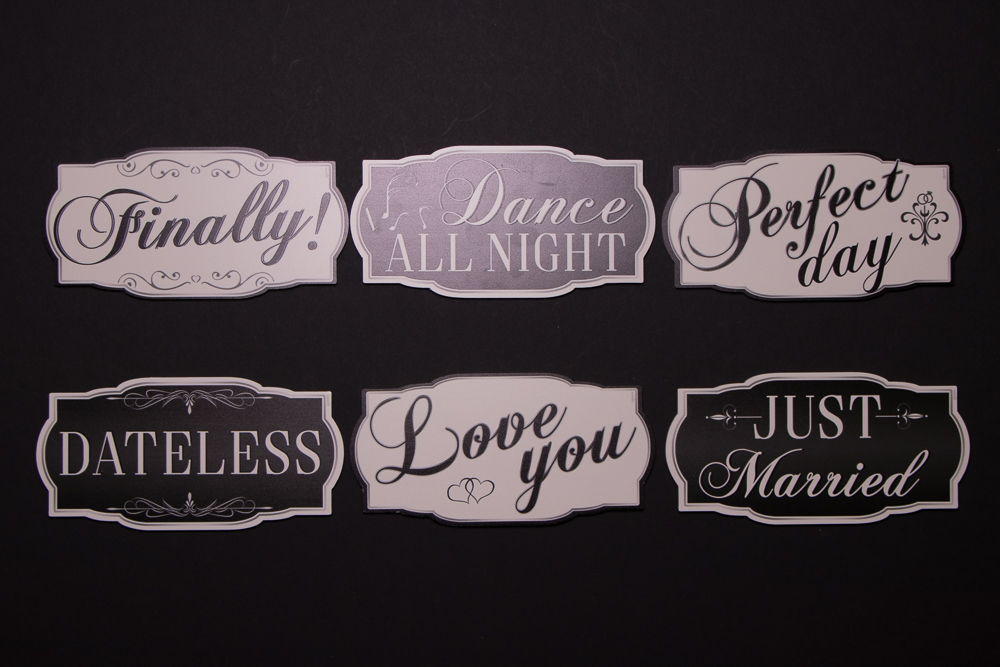 "Wedding Sign Package has six signs, they are: ""Finally!"", ""Dance All Night"", ""Perfect Day"", ""Dateless"", ""Love You"", and ""Just Married""."