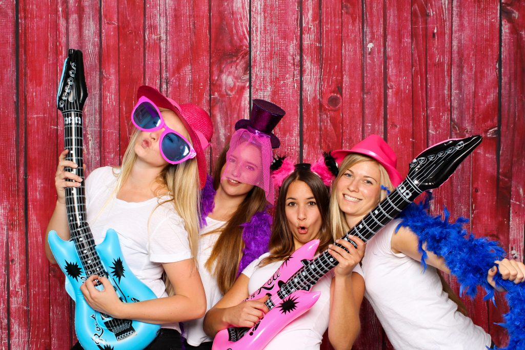 Girls Having Fun In The Photo Booth